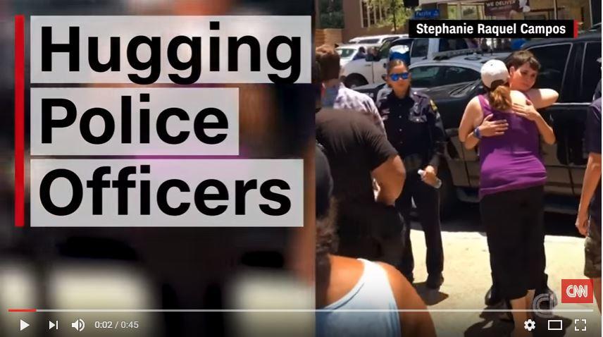 hugging police officers
